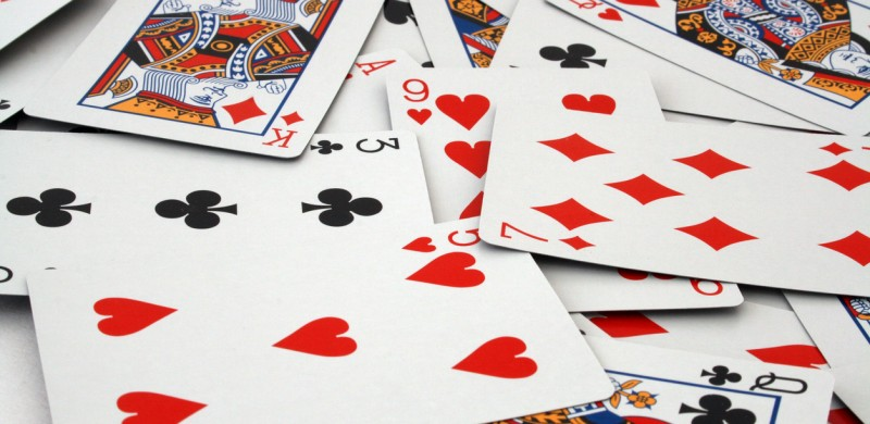 full frame image of a deck of playing cards scattered
