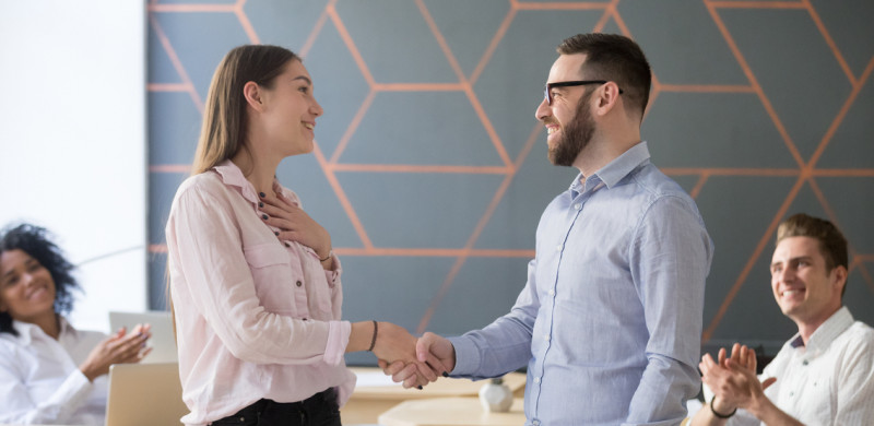 Team leader shaking hand employee congratulating with rewarding, appreciating for good work result while business team applauding, recognition concept