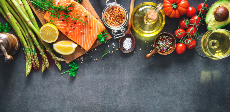 Cooking Preparation (Fresh salmon fillet with aromatic herbs, spices and vegetables.)