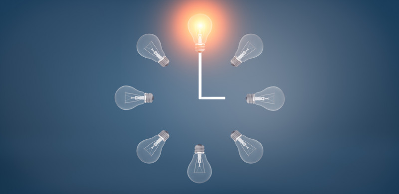 Clock with bulbs projecting the right time. Ideas and innovation.