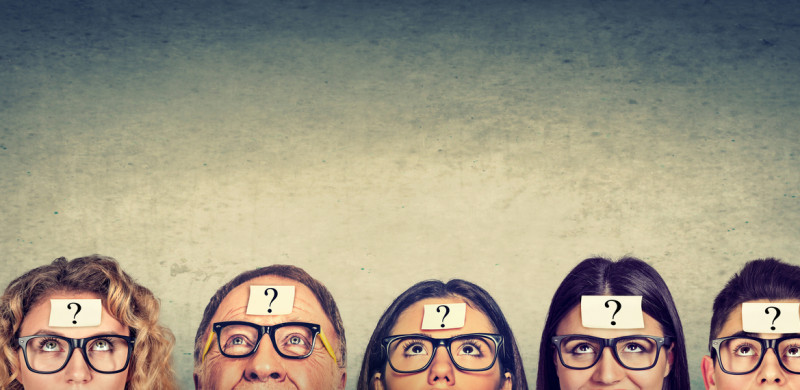 group of thinking people in glasses with question mark looking up