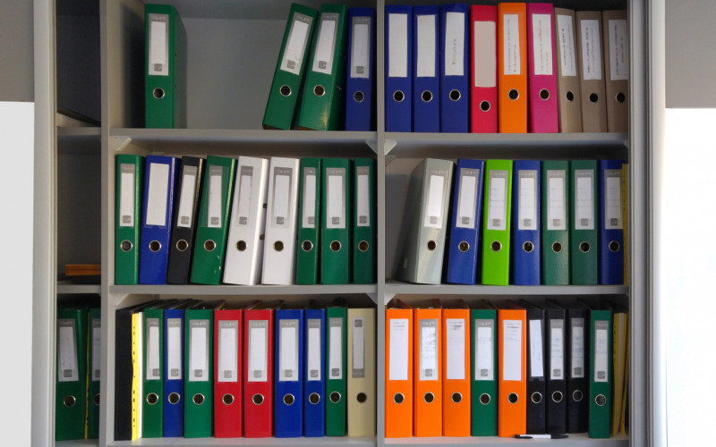 File shelf with labeled binders