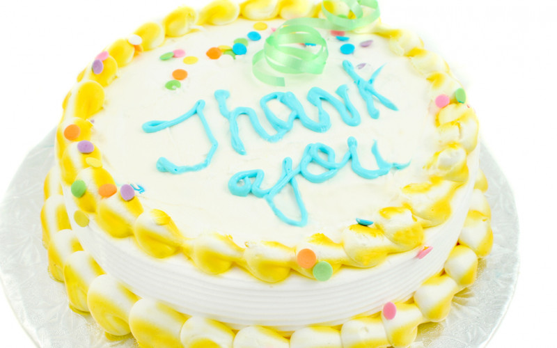 "cake with ""thank you"" written in frosting"