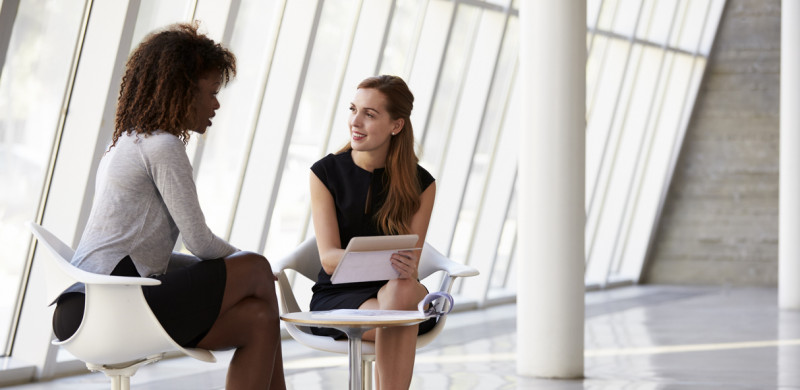 Two Businesswomen having a tough conversation using the D.E.S.K. model