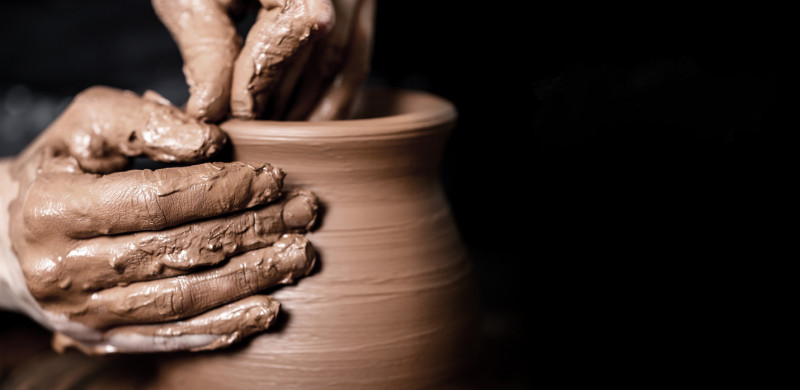 hands shaping pottery