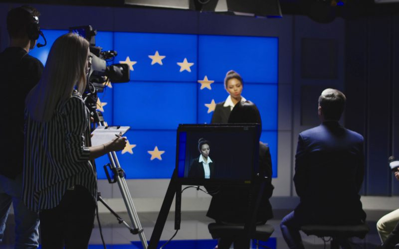 Female delivering crisis message to the media in a news studio
