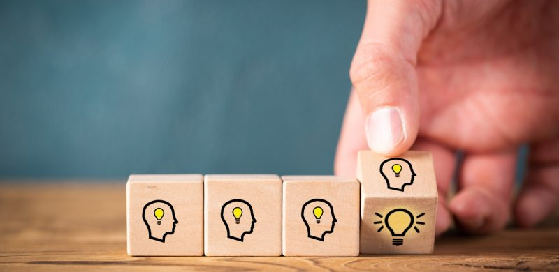 blocks of people thinking and a lightbulb