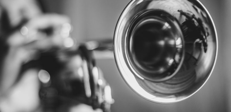 man playing trumpet in jazz band