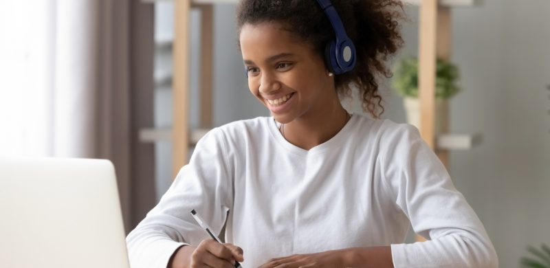 Student wearing headphone learning assessment header image