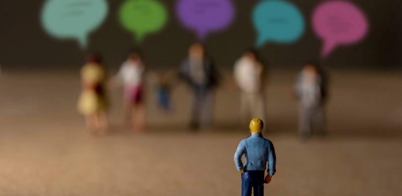 miniature figures of people depicting customer feedback
