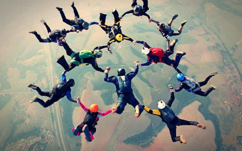 Skydivers linked in formation